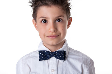 Close up portrait of eight year kid wearing papillon against whi