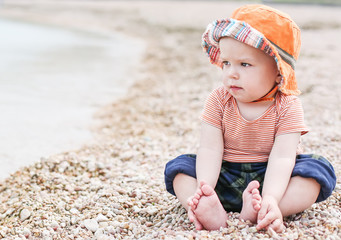 cute toddler baby  sitting on the beach