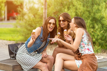 3 cute women, ice cream parlors, while laughing