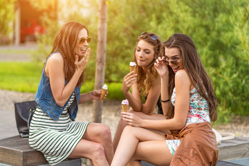 Three woman eating ice cream they look good guy