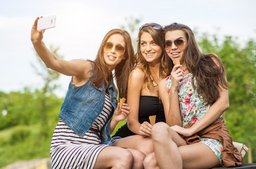 Selfie - Three beautiful woman eating ice cream in the City