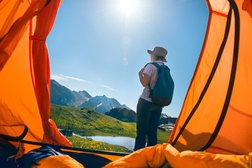 woman camping in mountains