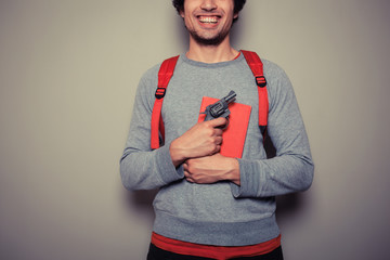 Student with gun and book