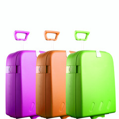 three colored suitcases isolated on white