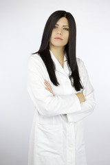 Serious confident female doctor looking