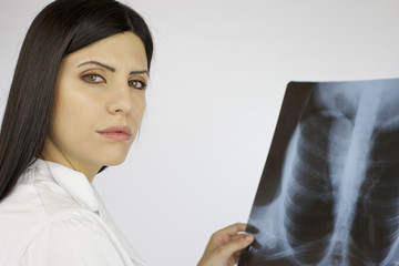 Serious worried doctor with xray