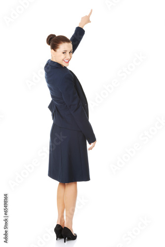 Business woman pointing on copy space.