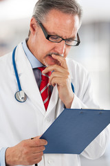 Doctor reading a case history
