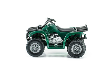 Green ATV toy isolated on white