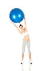 Fitness girl working with pilates ball