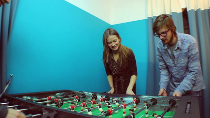 People playing table soccer, team-building, socializing, resting
