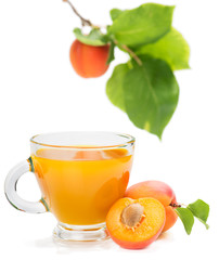 apricot juice and apricots with leaves