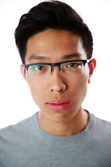 Portrait of a handsome asian man in glasses