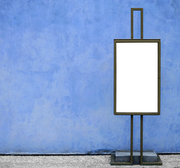 Blank billboard against blue concrete wall