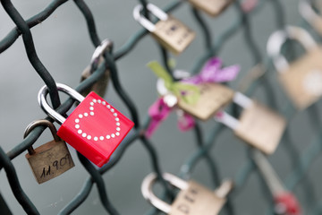Red padlock with studded heart