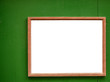 Blank frame on green wood wall
