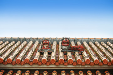 Okinawa style roof with lion doll, Japan