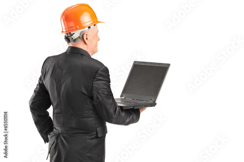 Mature architect holding a laptop