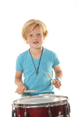 young boy drumming