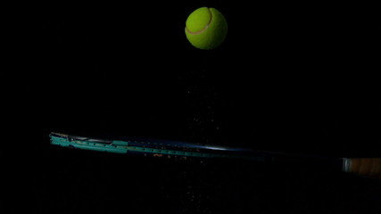 Tennis ball bouncing on a racket