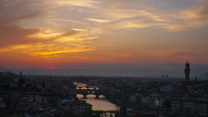 Sunset over bridges through the river Arno in Florence, timelaps