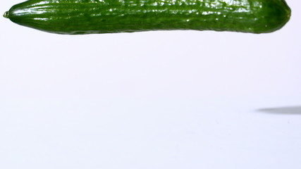 Courgette falling on white background