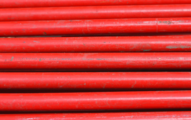 uniform background of red iron tubes