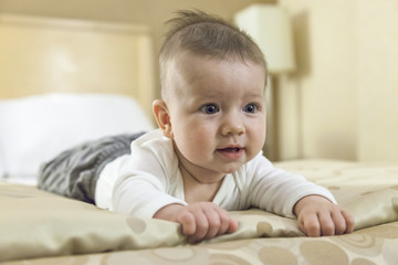 Close-up of a baby boy playing on a bed