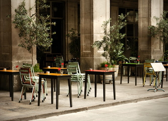 street cafe with colorful tables and chairs