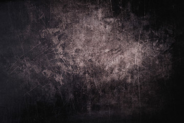 Dark grunge background with scratches