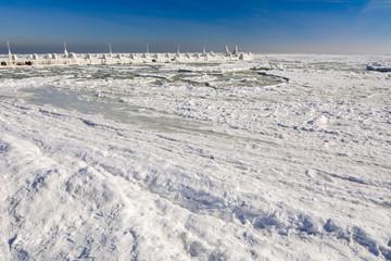 Frozen ice ocean coast - polar winter