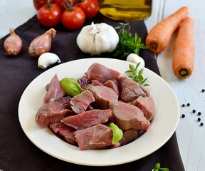 Raw beef for boeuf bourguignon with vegetables
