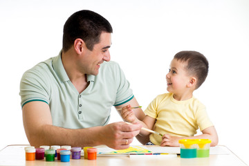 happy kid and dad paint together