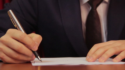 Businessman signing a contract, agreement, working in office