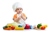 smiling baby cook with vegetables
