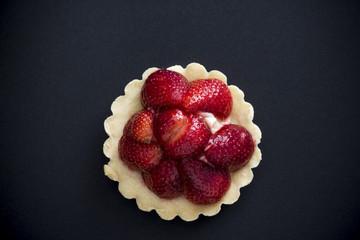 Strawberry tart on black background