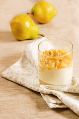 creamy dessert with caramelized pears and nuts