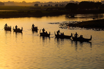 Silhouette of Tourist Boats at U bein bridge