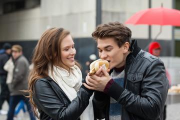 Woman Feeding Hotdog To Man