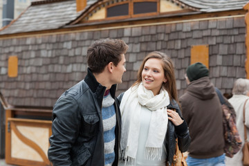 Couple Looking At Each Other Against House