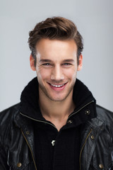 Fashion man smile face close up gray background