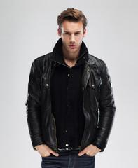 Fashion man, model leather jacket, gray background