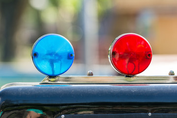 Red And Blue Sirens On Car Top