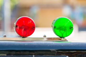 Red And Green Sirens On Car Top