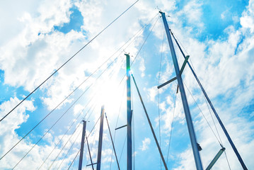 Sails against blue sky and sun