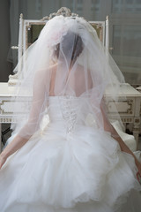 Bride looking at mirror