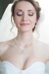 Portrait of young  happy bride looking down