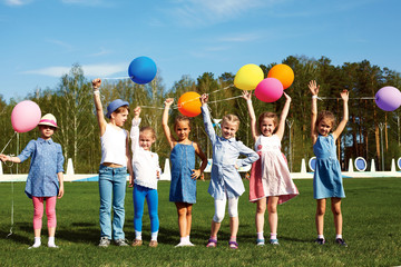 Big group of happy children with balloons