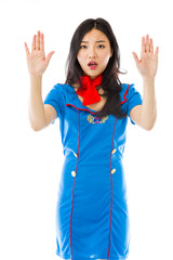 Asian air stewardess making stop gesture and showing stop