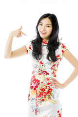 Asian young woman pointing at herself isolated over white